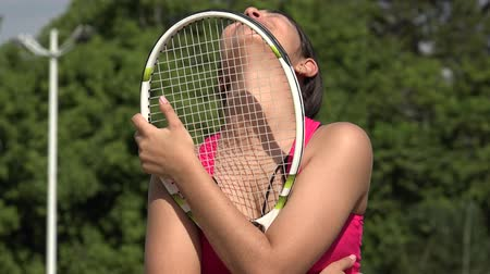 Athletic Female Teenage Tennis Player And Happiness