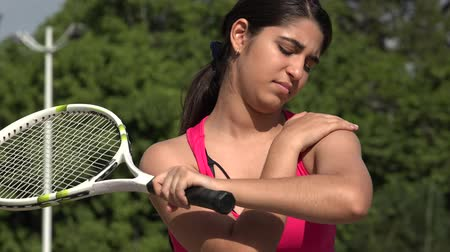 Athletic Female Teenage Tennis Player Soreness And Injury Stock Footage