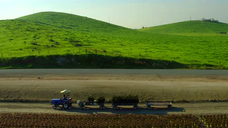 irrigate : Farm Lands Tractor Truck With Trailer  Mountains Bakersfields California Wide Aerial Moving  slow Evening Sunset