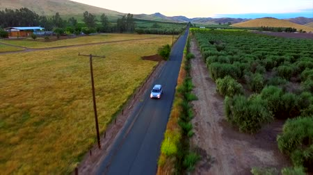 pursuit plane : Farm Truck Farm Lands Mountains Bakersfields California Wide Aerial Wide Moving Evening Sunset Stock Footage