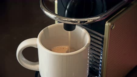 coffee grounds : Coffee filling a cup Stock Footage