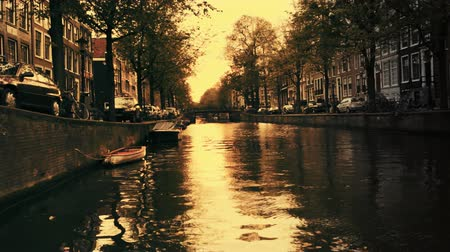 sunset city : a shot of canal and street scene in amsterdam at sunset Stock Footage