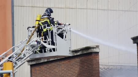 firemen : firemen hose down fire in barcelona