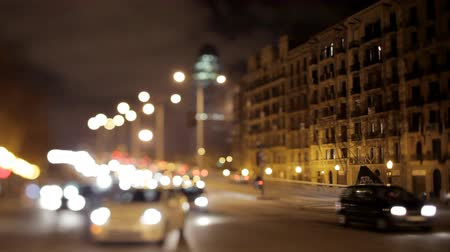Барселона : night shot of the torres agbar building in barcelona and traffic on the roads