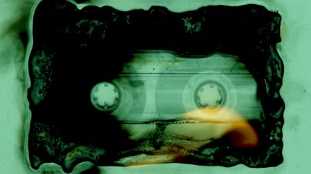 cassette : a cassette tape slowly being burnt and melting Stock Footage