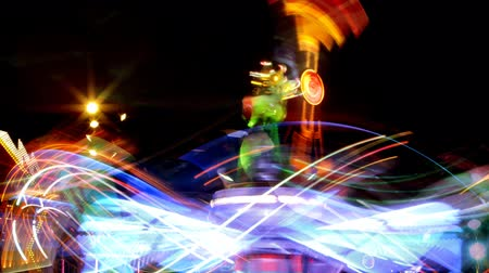карусель : timelapse of a fast ride carnival in barcelona spain, making light trails