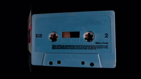 cassette : 3d effect of old audio cassettes being flipped through