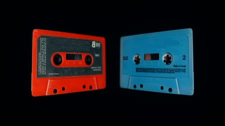 eject : 3d effect of old audio cassettes being flipped through