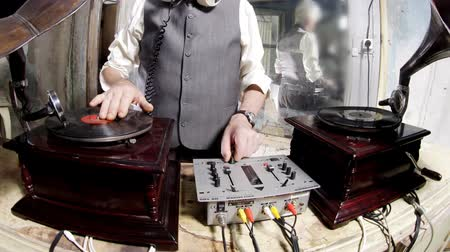 gravar : close-up crops of an older man djing with gramophones Stock Footage