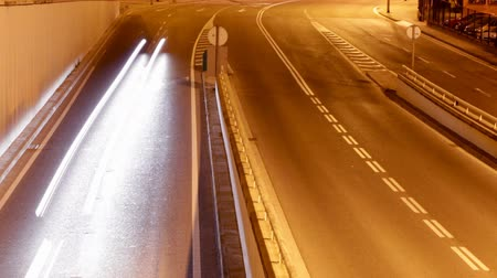 high speed road : rush of night time traffic on motorway in timelapse scene, barcelona, spain