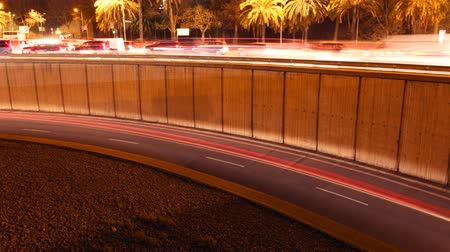 prędkość : rush of night time traffic on motorway in timelapse scene, barcelona, spain