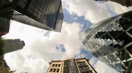 properties : fisheye shot looking up to the sky capturing the swiss RE (gherkin) building in london Stock Footage