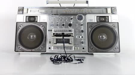 cassette : stopmotion of a fantastic looking retro ghetto blaster with cassette tape spilling out
