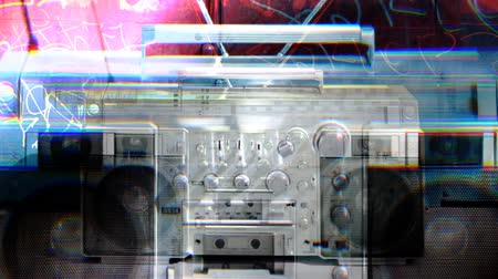 cassette : stopmotion of a retro stereo ghettoblaster in different urban locations, tracked so it looks almost in the same place in each shot Stock Footage