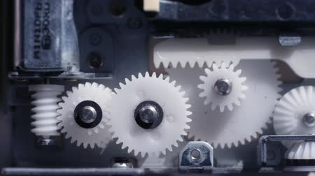 заводной : internal gears and cogs from inside a laptop