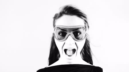 human eye : woman wearing retro goggles making faces Stock Footage