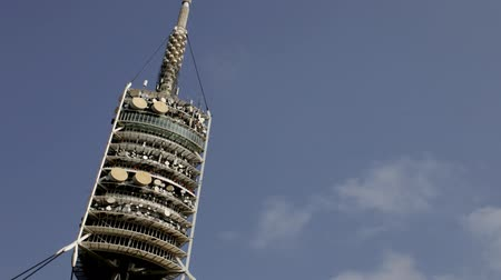 telecoms : Timelapse shot of the Torre de Collserola communication tower in barcelona with clouds passing behind