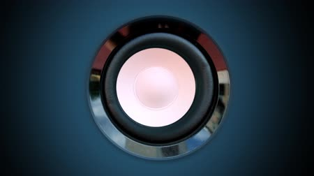 loud music : a speaker cone pumping to the sound of the bass