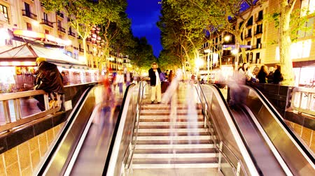 Барселона : people going up and down a subway entrance in barcelona spain