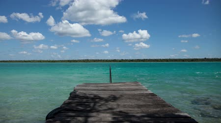timelapse shot of the beautiful lake bacalar, with crystal clear blue water, quintana roo, mexico Dostupné videozáznamy