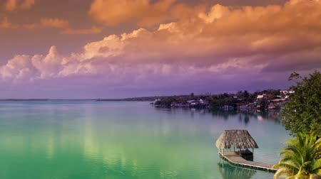 cisza : timelapse shot of the beautiful lake bacalar, with crystal clear blue water, quintana roo, mexico. this version is heavily filtered in post to push the colours for an fantastical dreamy feel