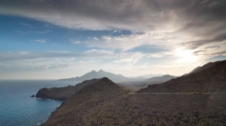 almeria : Time lapse looking out to sea with mountains in the background on a beautiful afternoon in, cabo de gata, spain Stock Footage