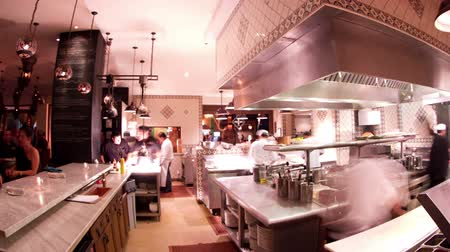 cooks : timelapse shot of chefs preparing food in a busy hotel restaurant kitchen Stock Footage