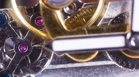 time machine : extreme macro close-up stop motion of a clockwatch with lots of gears and cogs Stock Footage