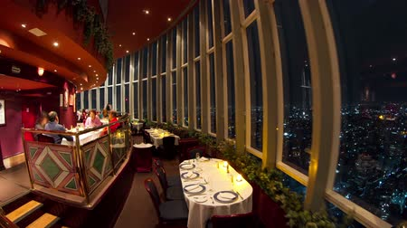 restoran : timelapse of the view from the rotating restaurant at the top of the world trade centre in mexico city, at night