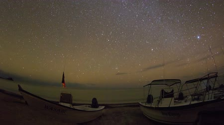 starlit : timelapse of stars at night of the ocean and boats in baja california sur, mexico Stock Footage