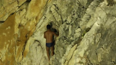 cliff : shots of the famous cliff divers in acapulco, mexico at night Stock Footage