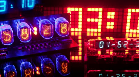 time machine : a collection of led and lit-up clocks and timers in the same shot Stock Footage