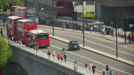 london england : buses and vehicles on waterloo bridge in london