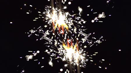 jiskří : a sparkler being ignited making abstract pattern shot in super slow motion