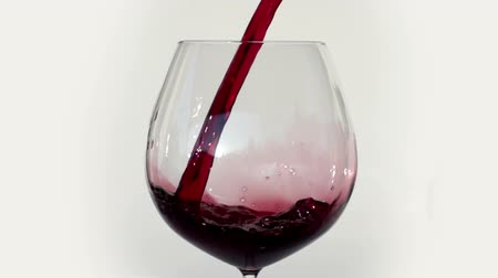 elegancia : red wine being poured into glass shot in super slow motion with the sony FS700 high speed camera
