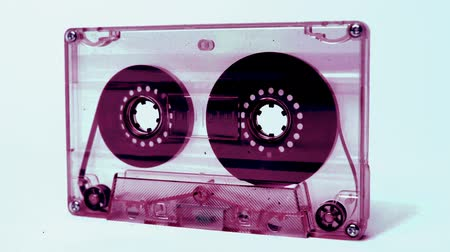 cassette : sequence of old audio cassettes in a retro tape player Stock Footage