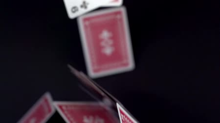 kart : a pack of cards being thrown in the air shot in super slow motion Stok Video