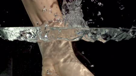 кулак : slow motion shot of a hand punching into water, shot with the sony FS700 Стоковые видеозаписи