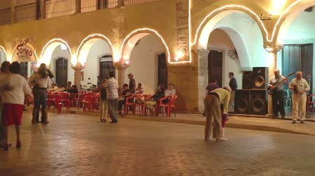 serenade : live band plays outdoors in the town of Valladolid in mexico. audio included