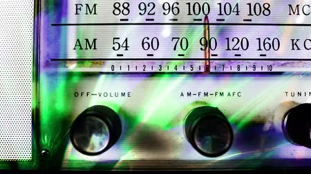 novela : a vintage radio changing the frequency and overlayed with abtract light effects