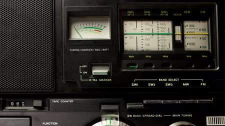 novela : close up of an retro radio with the marker running through the different stations and frequencies Stock Footage
