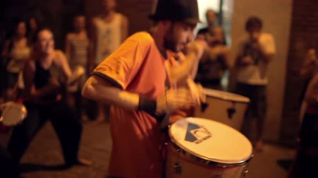 brasileiro : a troupe of brazilian style drumers play during a street festival in barcelona, spain. high quality audio captured