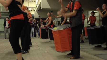 instrumento : a troupe of brazilian style drumers play during a street festival in barcelona, spain. high quality audio captured