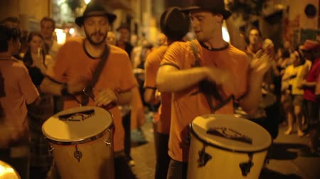 perkusja : a troupe of brazilian style drumers play during a street festival in barcelona, spain. high quality audio captured