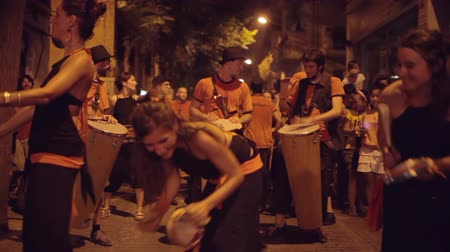 desfile : a troupe of brazilian style drumers play during a street festival in barcelona, spain. high quality audio captured