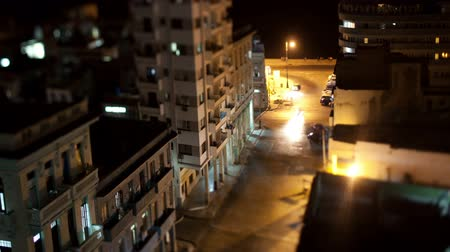 kuba : tilt and shift nighttime timelapse looking down onto the street in havana, cuba