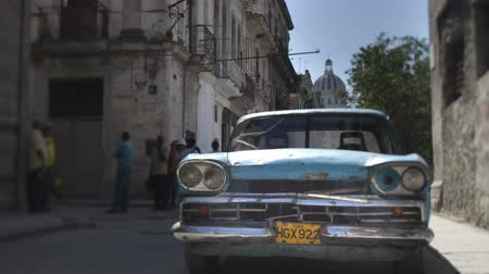 kuba : time-lapse of a street scene with a classic car in havana, cuba