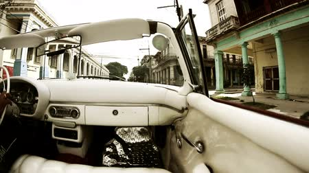 kuba : Havana street scene shot from a classic convertible car, Cuba