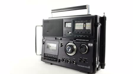 novela : stopmotion of a cool vintage radio receiver and tape player spinning around