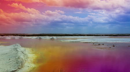 river ocean : timelapse of stunning shallow sea made pink in colour from the surrounding salt flats, ria largartos, mexico (colours further pushed in post for dreamy effect)